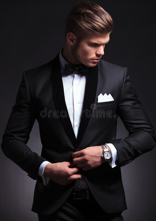 Business man buttons his tuxedo jacket royalty free stock image