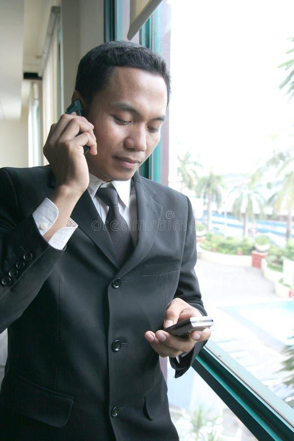 Business man calling stock photos