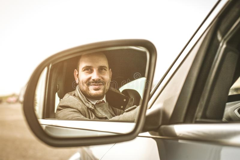 Business man in car. Smiling business man sitting in car. Close up royalty free stock images