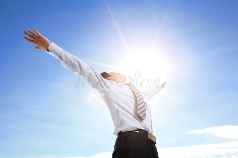 Business man carefree outstretched arms royalty free stock photography