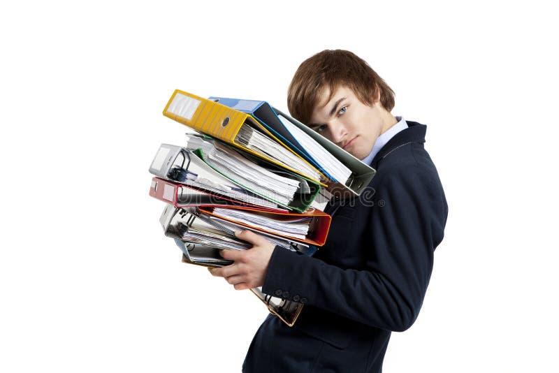 Business man carrying folders stock photo