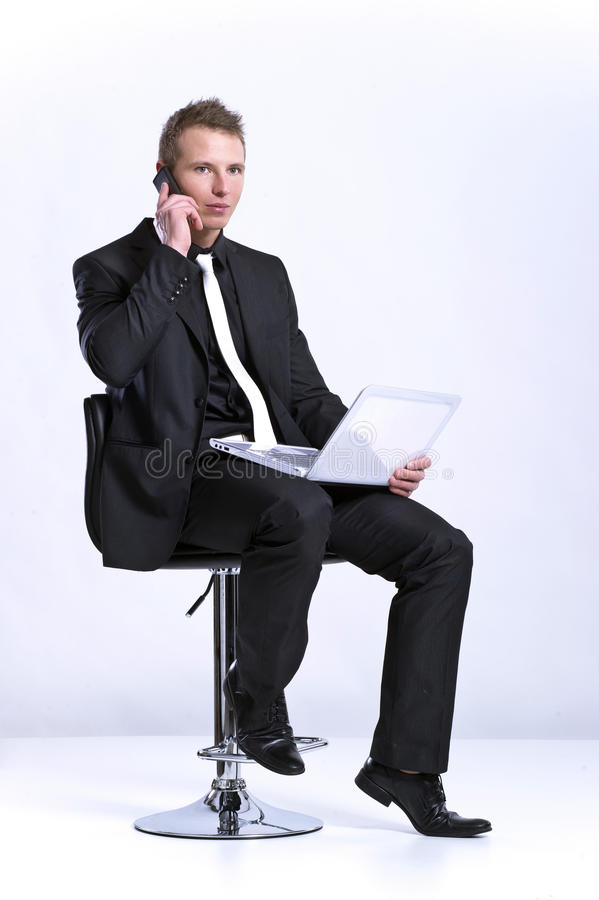 Download Business Man On Cell Phone In Front Of Laptop Stock Image - Image: 24778147