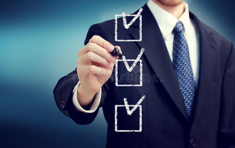 Business man with checkboxes stock photo