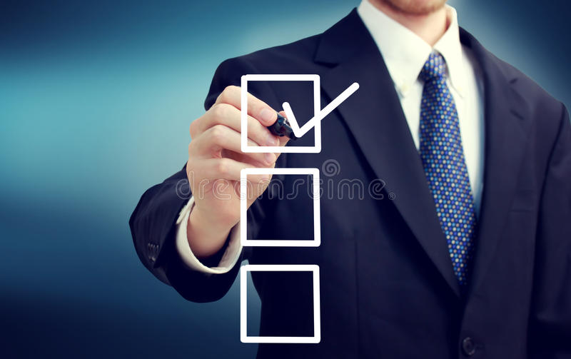 Business man with checkboxes stock photos