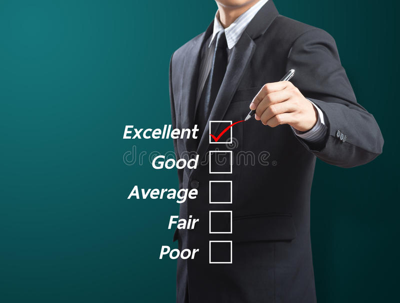Business man checking excellence stock images