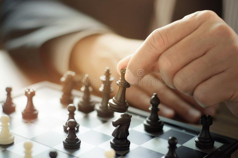 Business man with chess board game, strategy and competition royalty free stock image