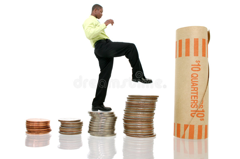 Business Man Climbing Coin Stacks royalty free stock photo