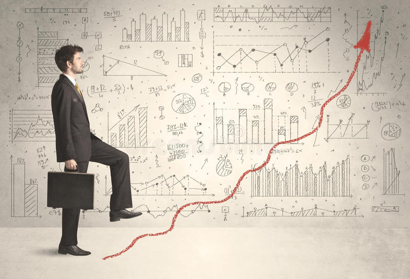 Business man climbing on red graph arrow concept stock images