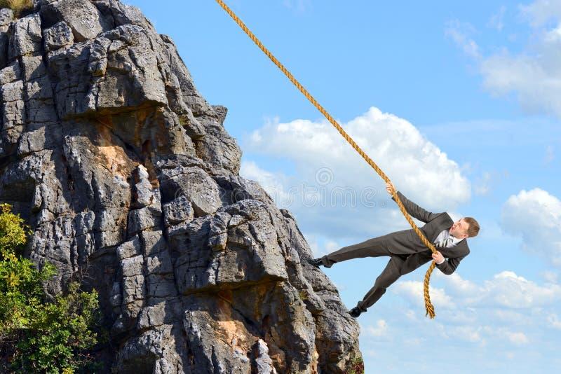 Business man climbs mountain stock images
