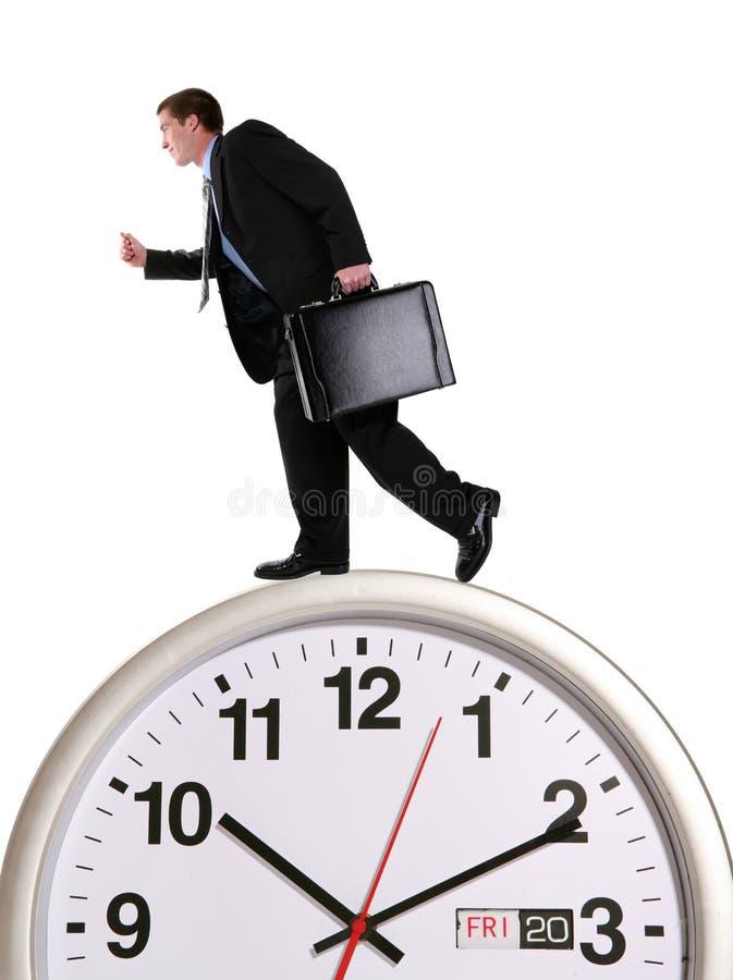 Business Man on Clock stock photo