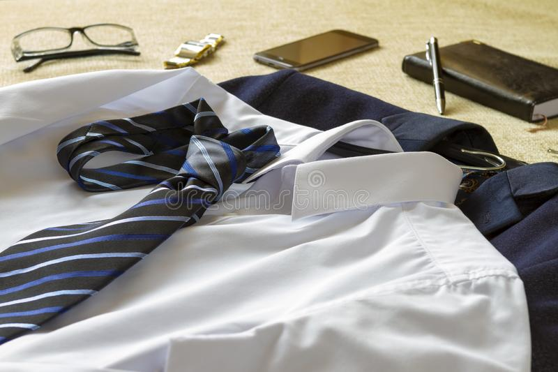 Business man clothes and accessories on bed royalty free stock photography