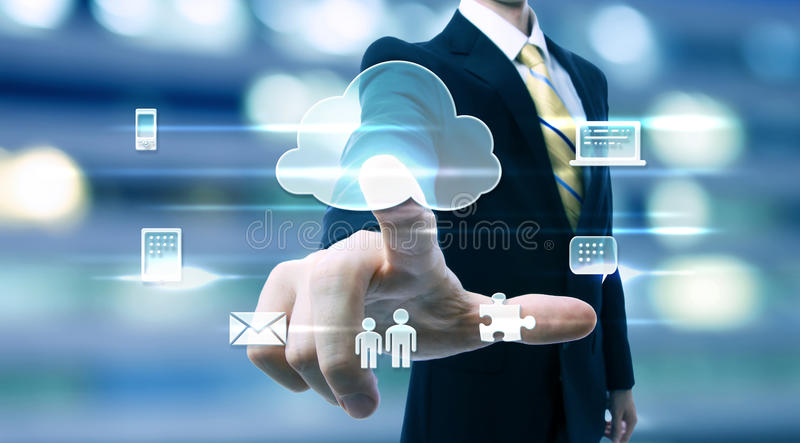 Business man with cloud computing concept. On blurred city background stock images