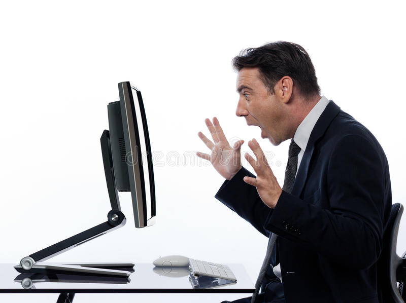 Business Man computer computing surprised. One caucasian business man computing and a computer display monitor on isolated white background royalty free stock photo