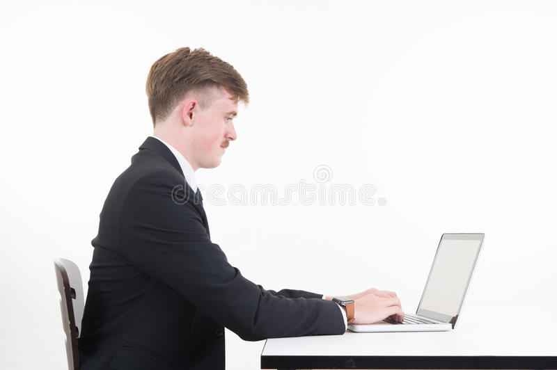 Business man with computer on white background. A business man with computer on white background stock images