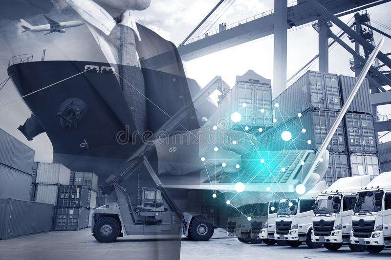 People working with technology. Business man is controling, commanding, working with shipping logistics industry mode all in by using laptop technology stock photo