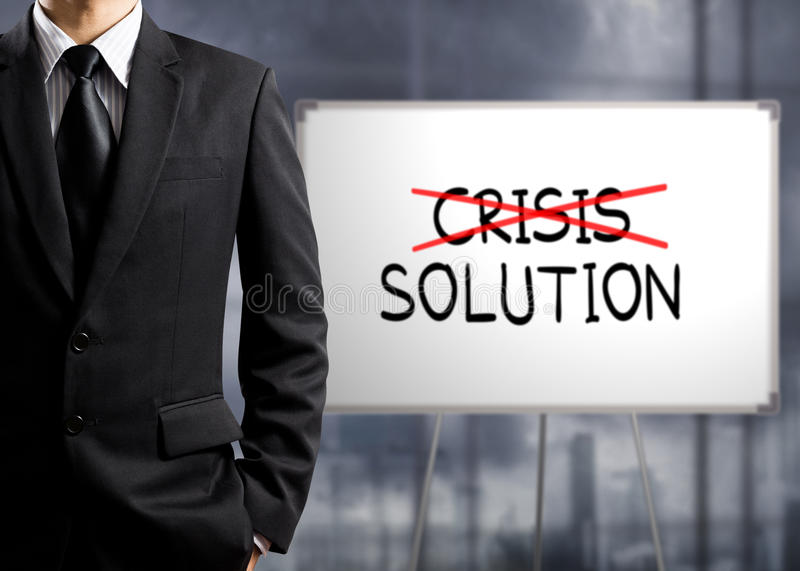 Business man cross crisis and find solution stock images