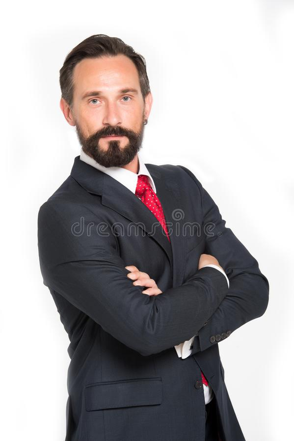 Business man with crossed arms smiling white background. Man in blue suit with red tie isolated in studio. Handsome bearded guy stock images