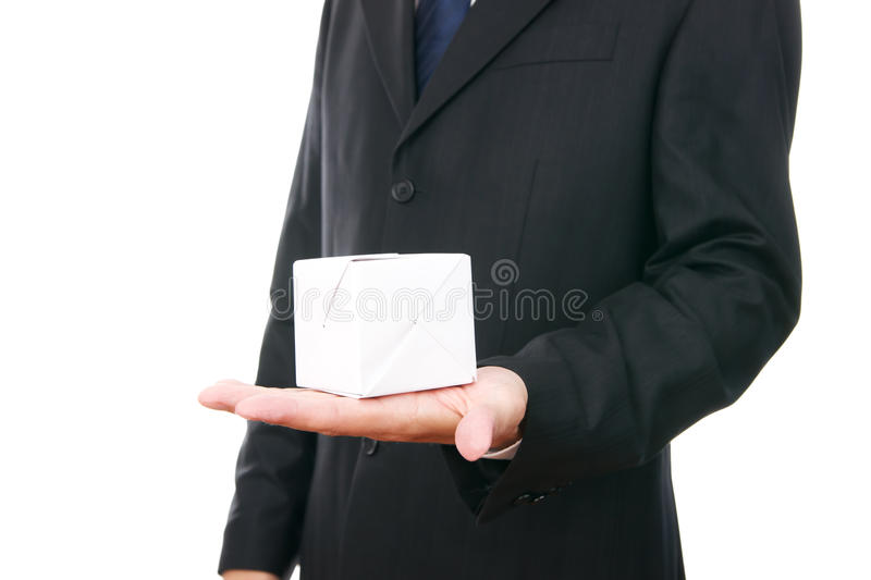 Business man with cube in hand royalty free stock images