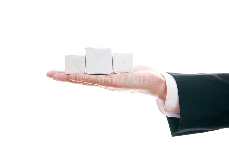 Business man with cube in hand royalty free stock photo