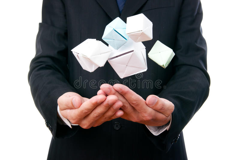 Business man with cube in hand royalty free stock image