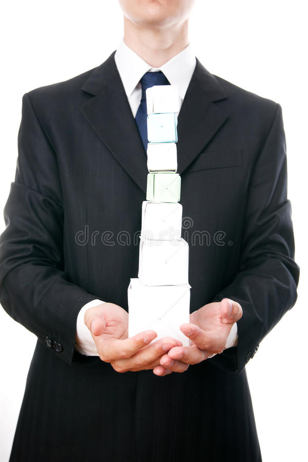 Business man with cube in hand royalty free stock photos