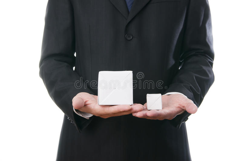 Business man with a cube in the hands royalty free stock photography