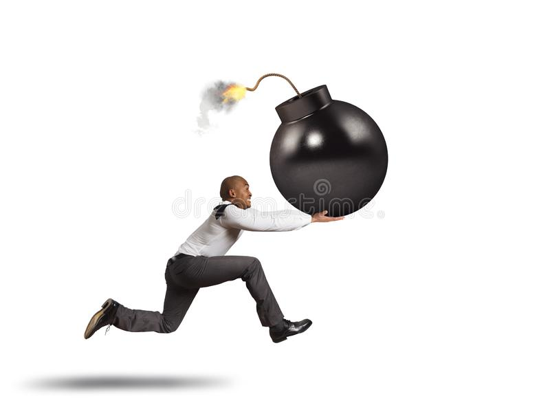 Business man in danger runs with a big bomb in his hand stock photography