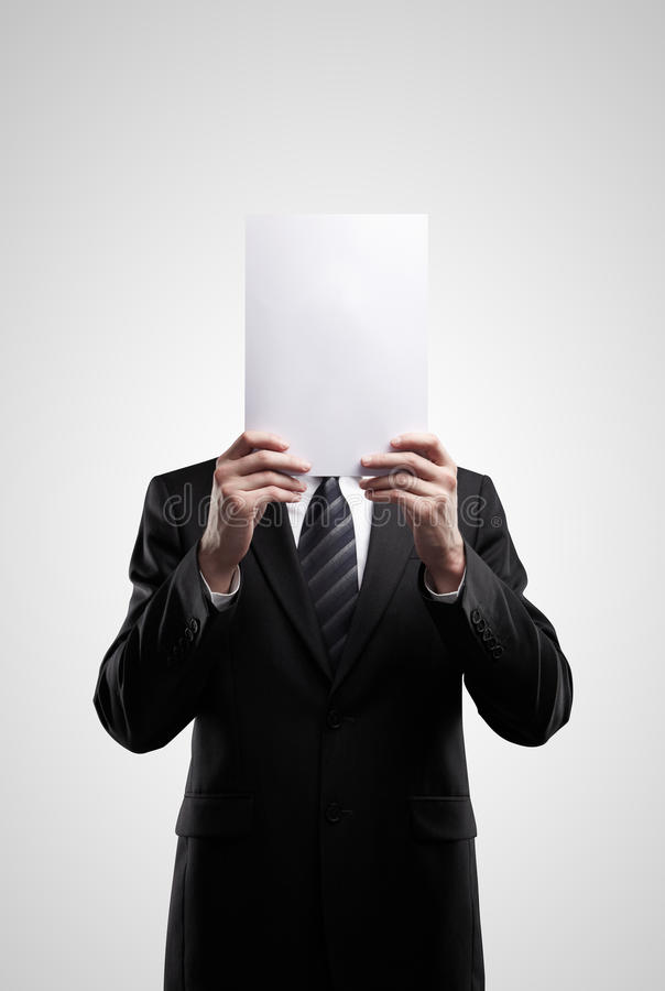 Business man in dark suit holding a blank sign royalty free stock photography