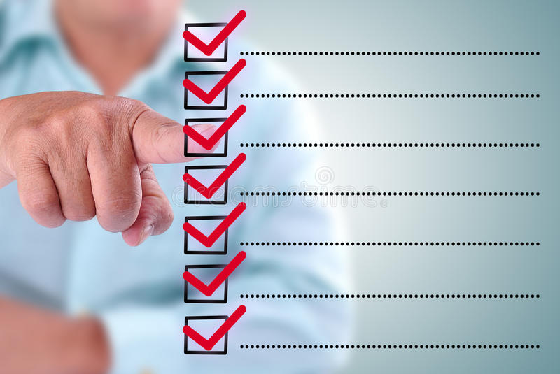 Business man designed on a checklist box royalty free stock photography