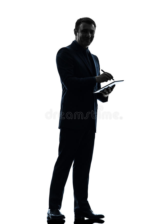 Business man digital pen stylus tablet silhouette. One business man holding digital pen stylus tablet in silhouette on white background royalty free stock images