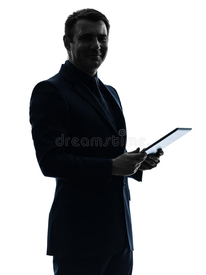 Business man digital tablet posing portrait silhouette. One caucasian business man holding digital tablet posing portrait on white background royalty free stock images