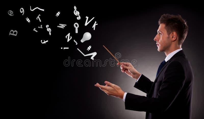 Download Business Man Directing Lots Of Symbols Stock Image - Image: 27318691