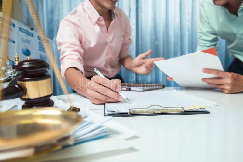 Business man discussing very seriously in the workplace, teamwork hipster vintage style. stock photography