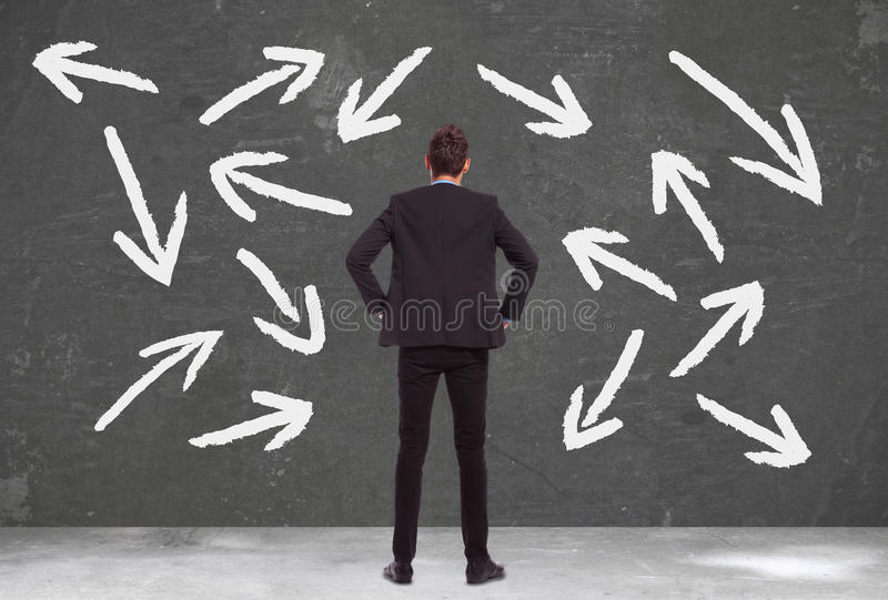 Business man does not know which way to go stock photos