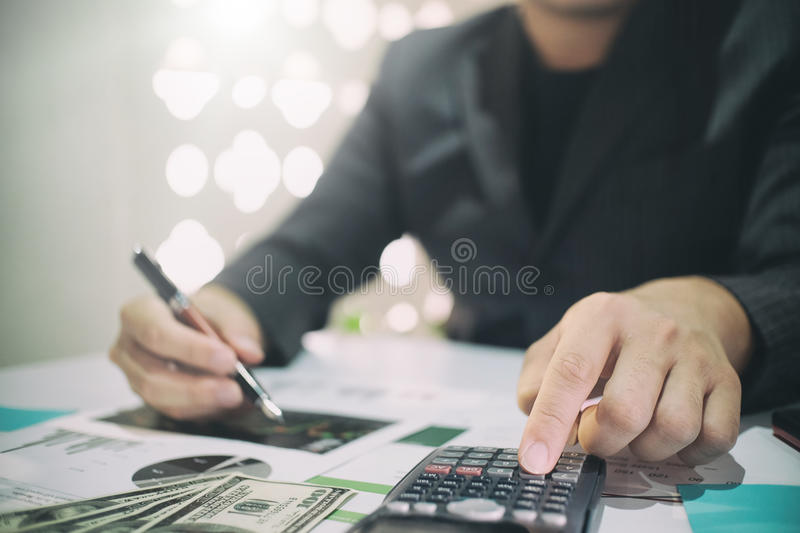 Business man doing finances on calculate analysis working. Business man doing finances on calculate analysis working with financial results Financial accounting royalty free stock images