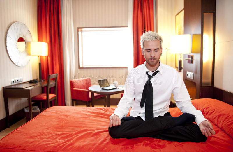 Business man doing yoga stock images