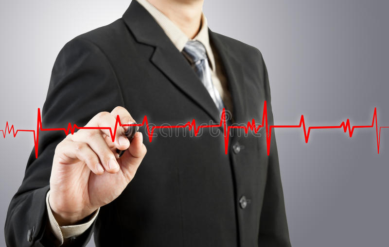 Business man drawing chart heartbeat stock images