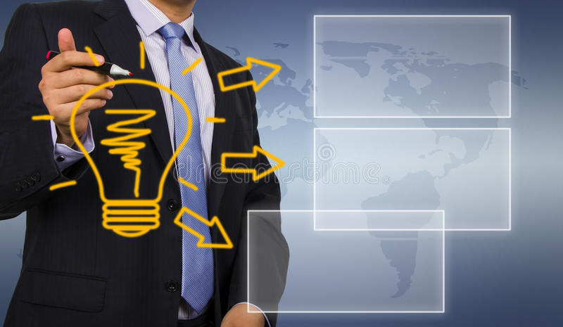 Business man drawing idea bulb. On Touch Screen Interface royalty free stock photography