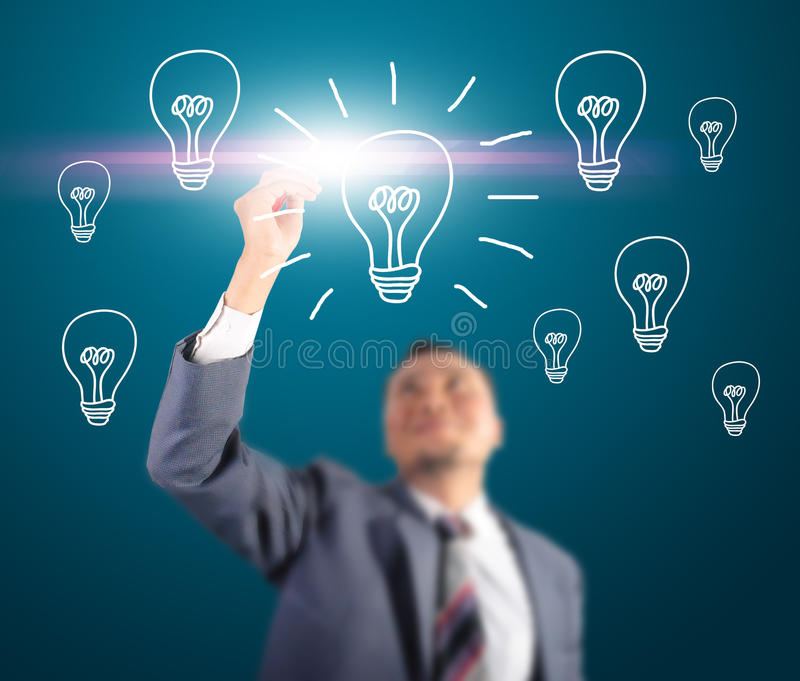 Business man drawing light of idea. With all of lamps stock images