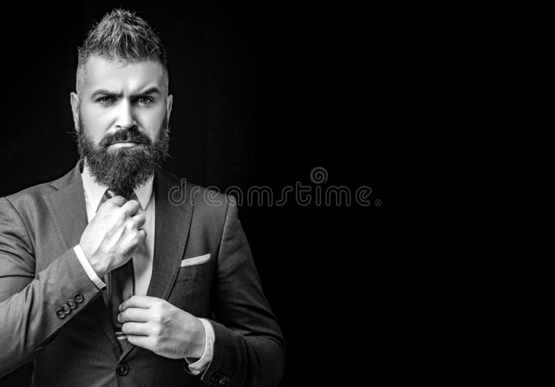 Business man dressed in classic suits. Elegance casual dress. Fashion suit. Bearded modern mens on black cackgriund stock image