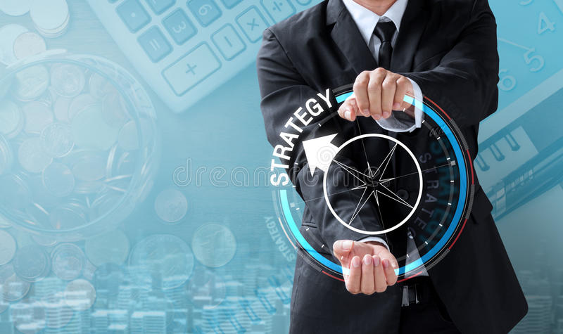 Business man drive compass to strategy royalty free stock photography