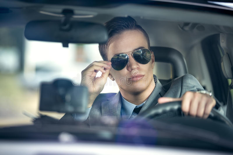 Business man driving a car stock photo