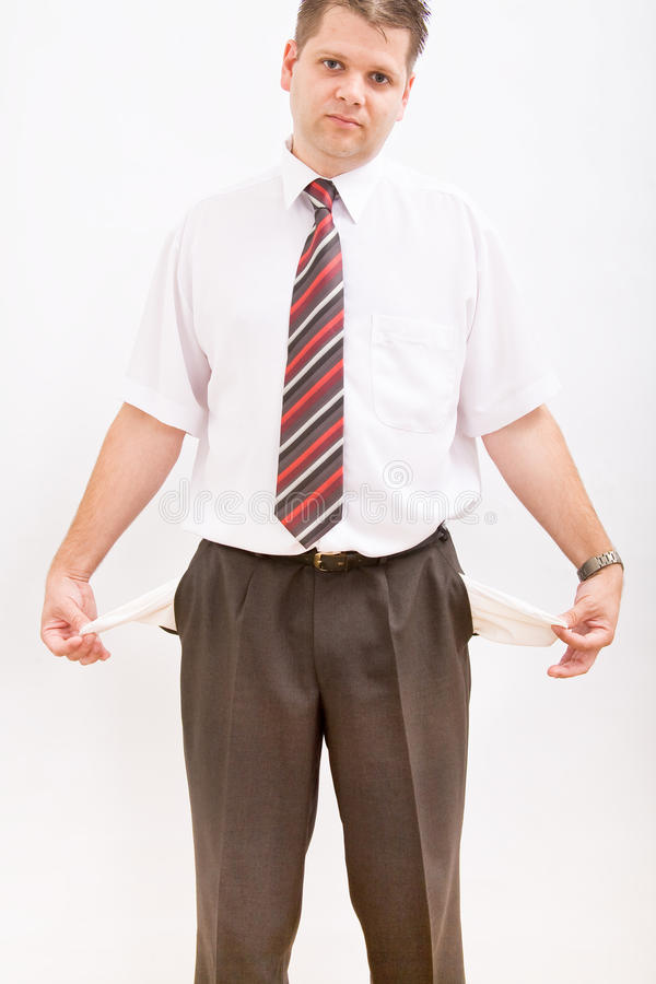 Business man with empty pockets stock image
