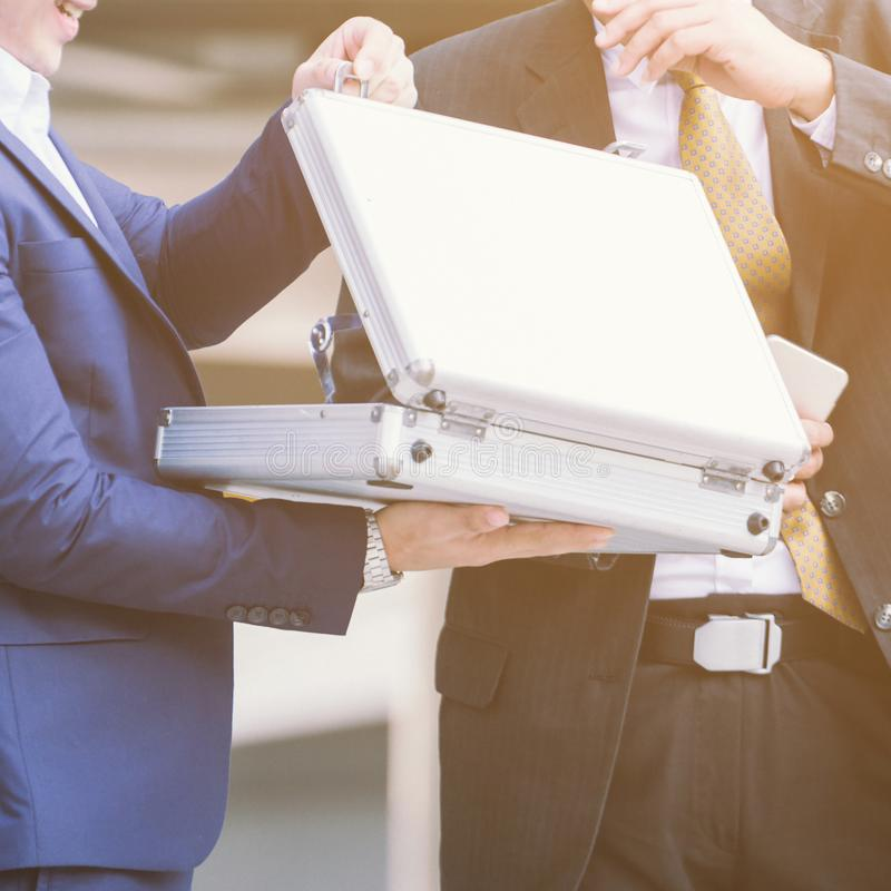 Business man exchange briefcase open suitcase. stock photos