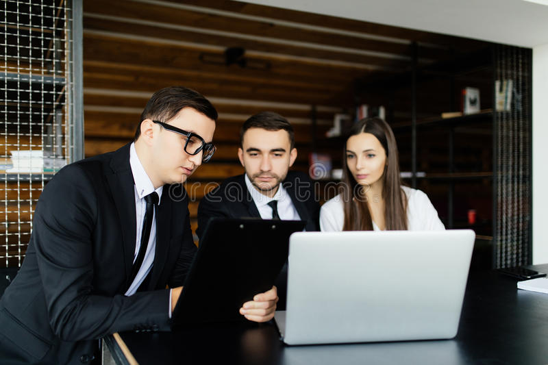 Business man explain documents details for team in office. royalty free stock images
