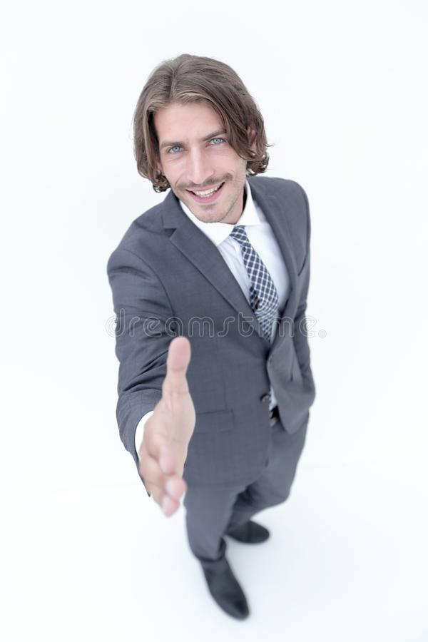 Business man extending hand to shake - focus om hand. Smiling middle aged businessman offering handshake on white background stock images