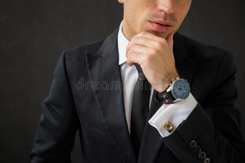 Business man with fancy wrist watch. And cuff-links royalty free stock images