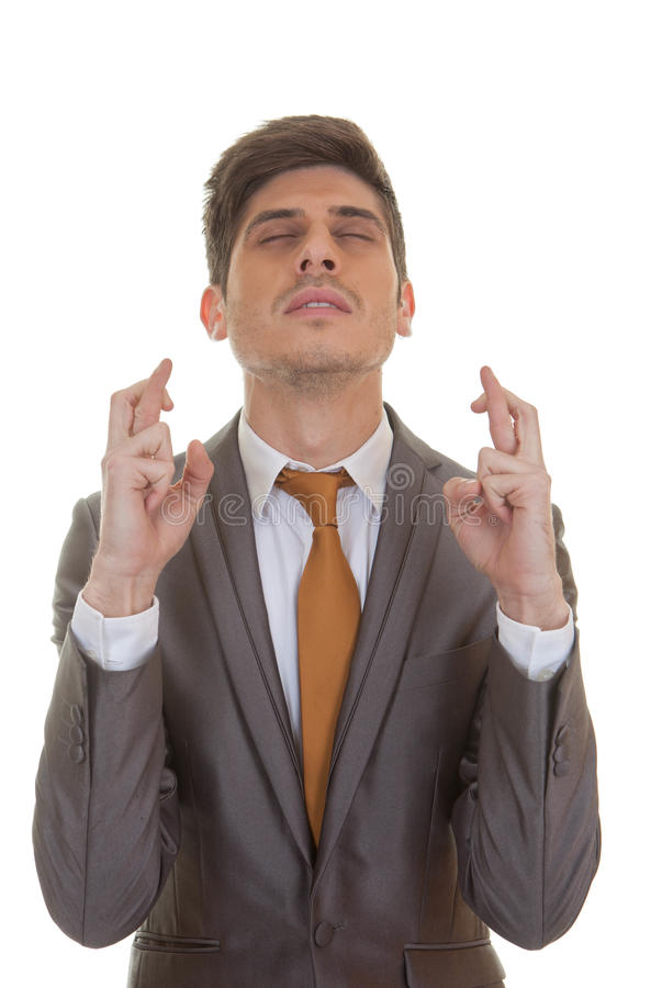Business man fingers crossed eyes closed royalty free stock images