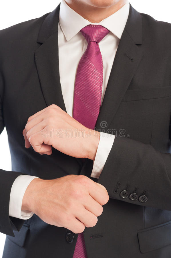 Business man fixing his shirt sleeve stock images