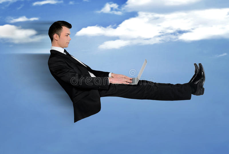 Business man fly using computer. Business man speed fly using computer royalty free stock photo